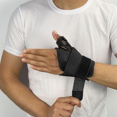 dunimed premium duimbrace polsbrace gedragen door mannelijk model